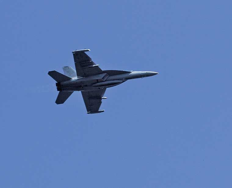 A Navy EA-18G Growler electronic warfare jet from Naval Air Station Whidbey Island on a low pass over Jefferson County. 2016 photo by Patrick Sullivan