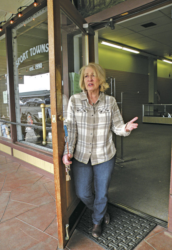 Susan Jacobs stands in the doorway of Sport Townsend, where she had worked since 1995 and has owned since 2011. Jacobs closed the business last month. She said Quimper Mercantile, a community-owned store that opened in 2012, became more of a direct competitor than she had imagined. Photo by Allison Arthur