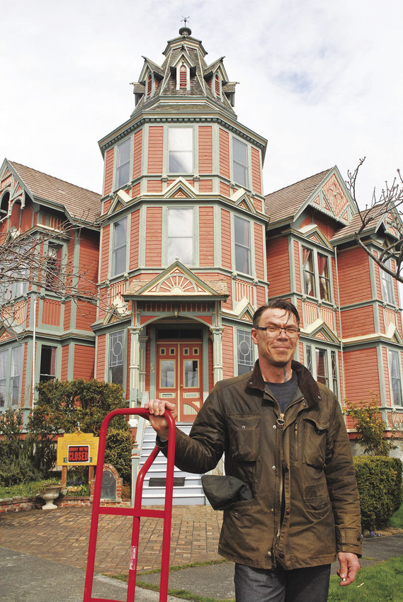 Christian Andrews stands outside the Ann Starrett Mansion at 744 Clay St. in Port Townsend on March 24. He and wife Cima have purchased the historic mansion from Bob and Edel Sokol for $775,000.Photo by Chris Tucker