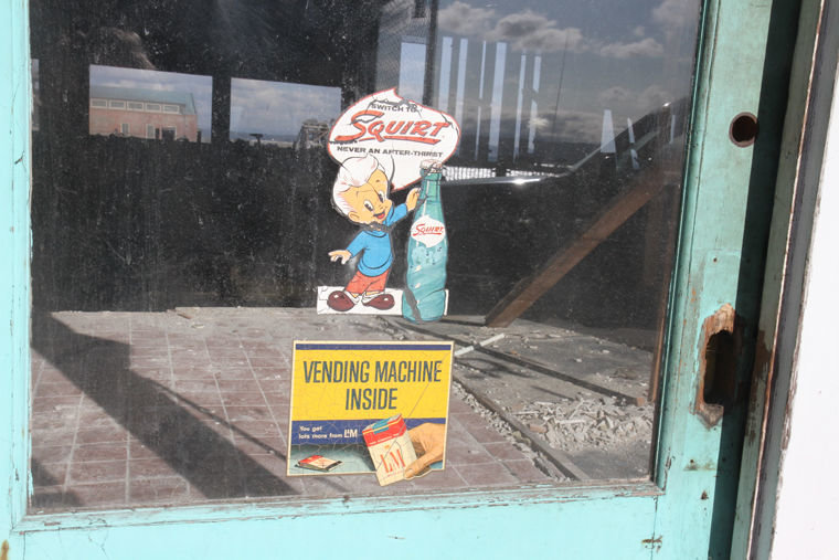 Layers of Port Townsend history are being revealed as layers of lumber are removed from the building on Taylor Street next to Union Wharf. The entrance to what in the 1940s-1960s had been the Palms Lounge was revealed last week, which includes a door with these advertisements for Squirt and L&M cigarettes. The property owners are seeking photographs showing the building during the 1930s through the 1980s. If you can help, contact Heather Dudley-Nollette at 206-387-9846 or heather@hastingsestate.com. Photo by Patrick Sullivan