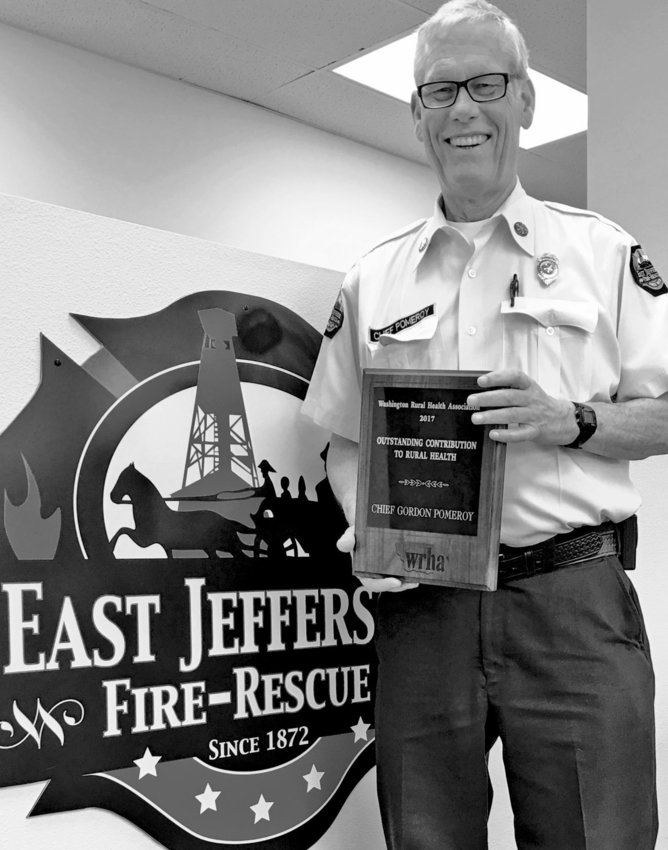 East Jefferson Fire Rescue Chief Gordon Pomeroy received the 2017 Outstanding Contribution to Rural Health award from the Washington Rural Health Association at a Feb. 28 ceremony in SeaTac. Courtesy photo