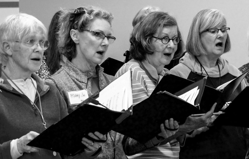 Altos (from left) Pat McMinds, Mary Jo Mackenzie, Cass Dahlstrom and Jody Glaubman rehearse for the Community Chorus concerts saluting the national parks, March 31 and April 2. Photo courtesy Sue Reid