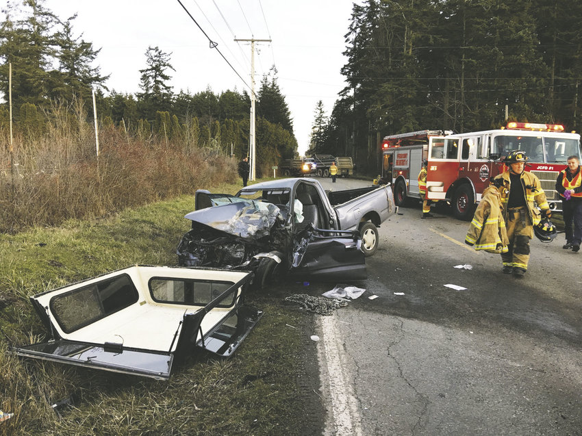 Hastings Avenue was closed Tuesday afternoon, Feb. 14 for several hours after a 67-year-old Port Townsend woman driving a gray Toyota Tacoma pickup truck crashed head-on into a dump truck owned by Seton Construction. Photo courtesy East Jefferson Fire Rescue