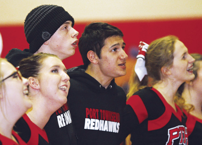 It's routine for members of the Port Townsend High School cheerleading program to lead the fans in a postgame rendition of the school alma mater. It's a special moment for the parents of Nick Hamon, a student with autism, to watch him participate. Pictured are (from left) Haily Tuthill, Kayla Calhoun, Nick Hamon, Juan Lopez and Lydia Arthur. Photo by Patrick Sullivan