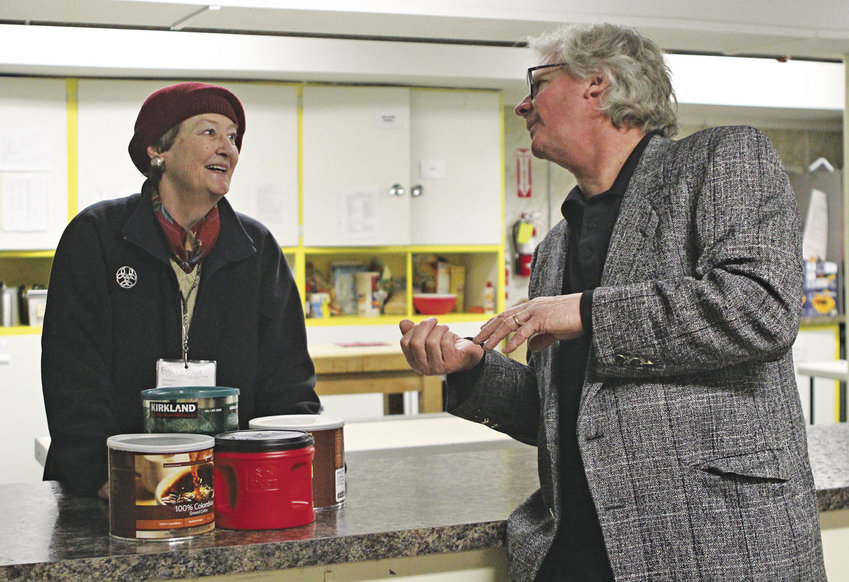 Port Townsend musician Paul Rogers (right) chats with Winter Shelter manager deForest Walker Feb. 9, after handing Walker a check for $2,250. Rogers raised the money through his Holiday Hi-Jinx Show, which took place in December. Photo by Katie Kowalski