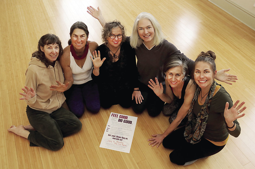 "Yoga teachers (left to right) Shanon Leonard, Tinker Cavallaro, Terry Wagner, Heather Sky, Renee Klein and Shayann Hoffer participate in the monthly ""Feel Good. Do Good"" yoga benefit. Other participating teachers, not shown, are Karyn Stillwell, Aliina Locklear and Christine Schoper. Courtesy photo"