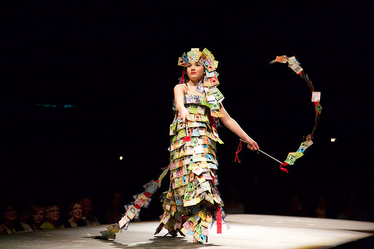 """Port Townsend student Emillia Nunn, 12, models her Best Student design, """"Crazy Card Creation,"""" during the 2016 Wearable Art Show at McCurdy Pavilion. The piece reflects the artist's obsession with Japanese anime. Photo by Steve Mullensky"""