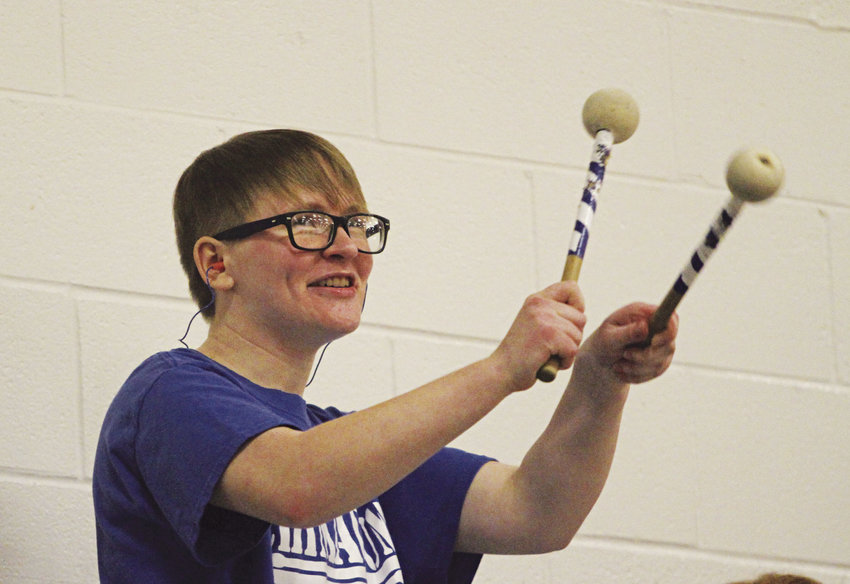 Grace Aman, a Chimacum High School sophomore, performs with the pep band during a varsity basketball game. The school district's award-winning music program is supported by taxpayer-approved maintenance and operations levy dollars. Photo by Patrick Sullivan