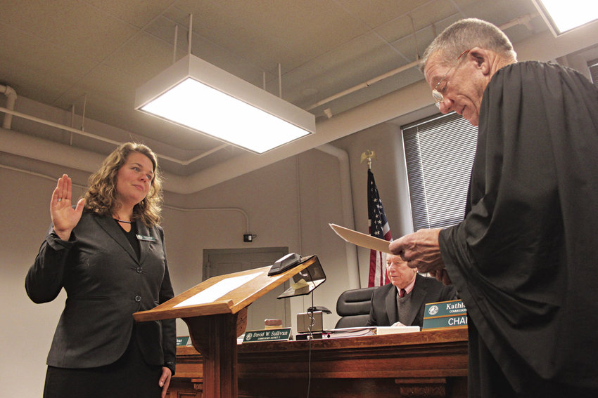 Kate Dean affirms her oath of office as the county commissioner for District 1, as Superior Court Judge Keith Harper swears her in Jan. 3. Photo by Kirk Boxleitner