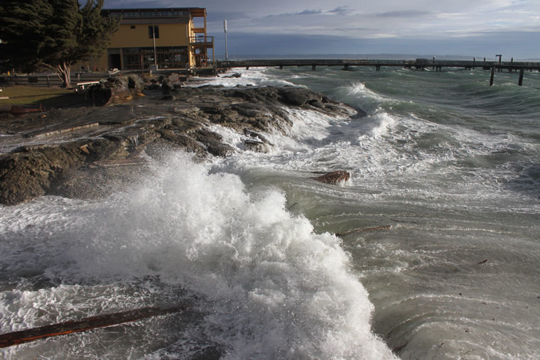 Winds blowing 31 knots at the time of a 9.34-foot high tide sent Port Townsend Bay onto land Tuesday morning, Jan. 17. This scene is at Pope Marine Park, looking at the Northwest Maritime Center. Photo by Patrick J. Sullivan