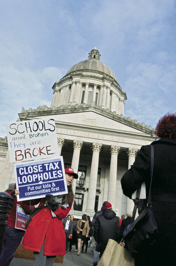 More than 6,500 students, educators and parents assembled across from the Capitol steps in Olympia Monday, Jan. 16 to voice their frustrations over the state Legislature's failure to fund basic education, its constitutional duty. Photo by Grace Swanson