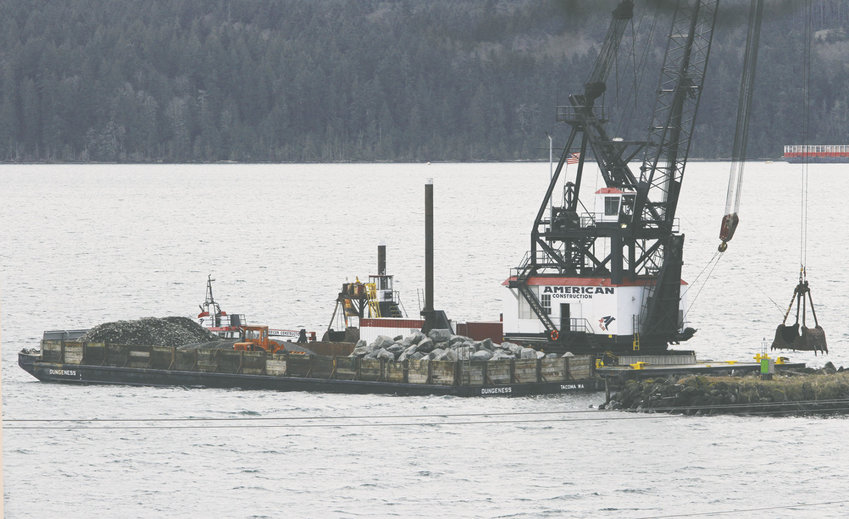 American Construction Co. crews began work Jan. 9 to repair the oldest section of the Port Townsend Boat Haven breakwater. Photo by Patrick Sullivan