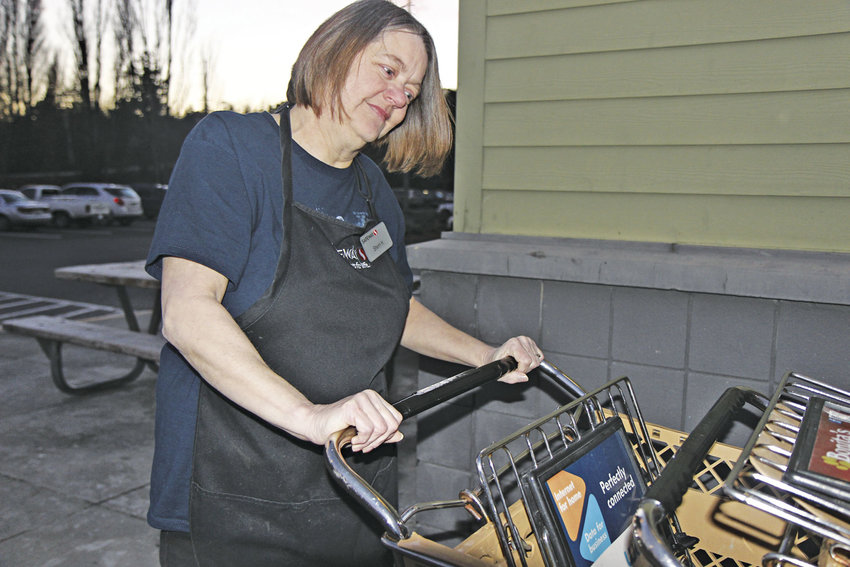 Sherri Howard recently graduated from wrangling shopping carts to working in the produce department at the Port Townsend Safeway. Photo by Kirk Boxleitner