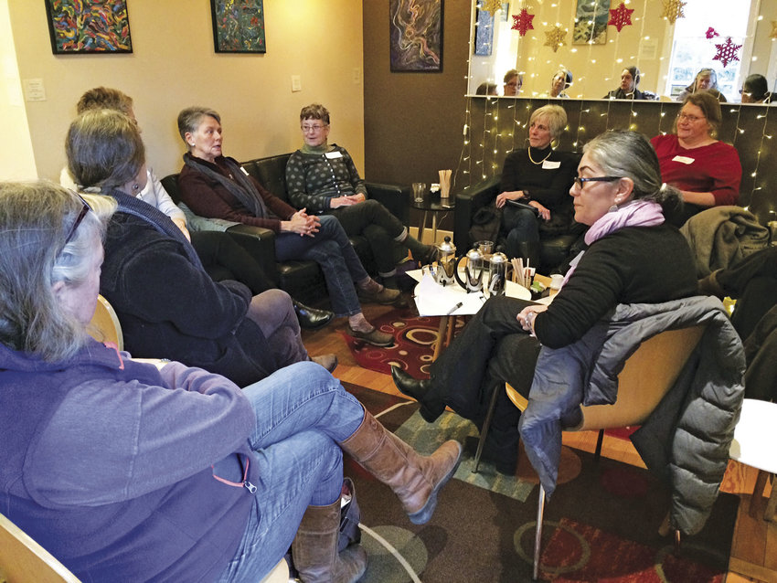 A dozen women from Jefferson County gathered Friday, Dec. 23 at Pippa's Real Tea in Port Townsend to discuss going to Washington, D.C., to attend the Women's March on Washington on Saturday, Jan. 21. The group, which is planning to meet up in D.C., is also hoping to help sponsor others who are interested in attending. Photo by Allison Arthur