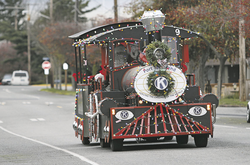 "The Kiwanis Club of Port Townsend has modified its George Earl Memorial Choo Choo with a roof atop the passenger ""coal car"" so riders this holiday season have been protected from rain or snow. Photo by Patrick Sullivan"