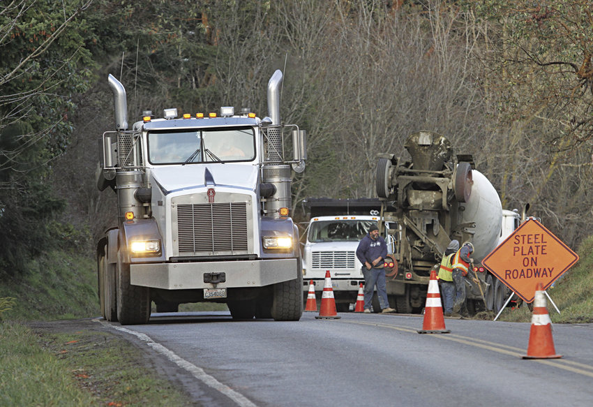 The City of Port Townsend's capital improvement focus for 2017 includes the Howard Street Extension project, which in late spring brings a roundabout to Discovery Road at Howard and Rainier. Last week, a concrete truck and dump truck were active in making water main improvements on Discovery Road as part of the project. Photo by Patrick Sullivan