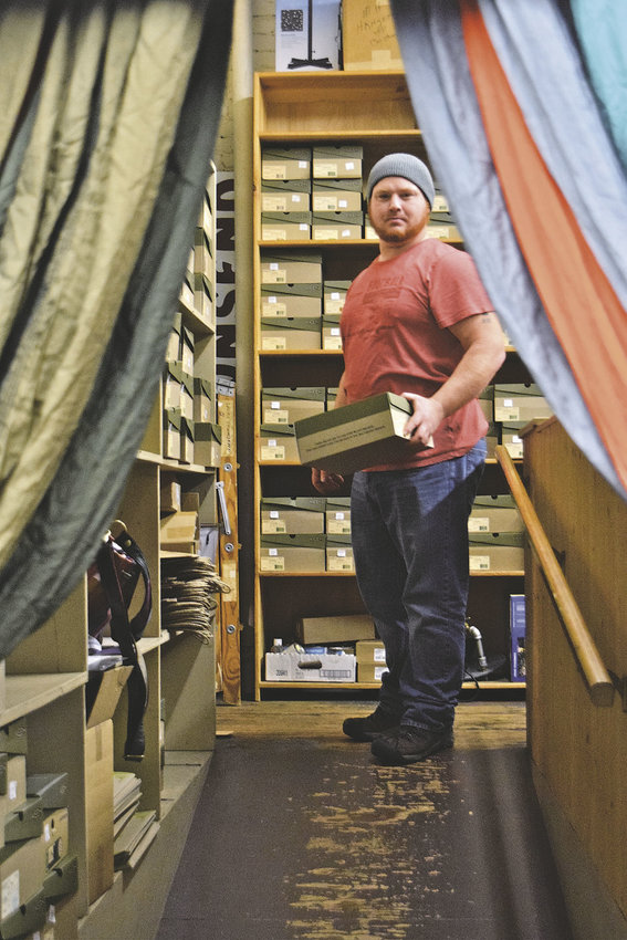 Stryker Gooch, a Sport Townsend employee, knows that small, independently owned businesses in places like Port Townsend rely on holiday-season sales to help carry them through the winter. Customer service is key, he noted. Photo by Maegan Sale Kennedy