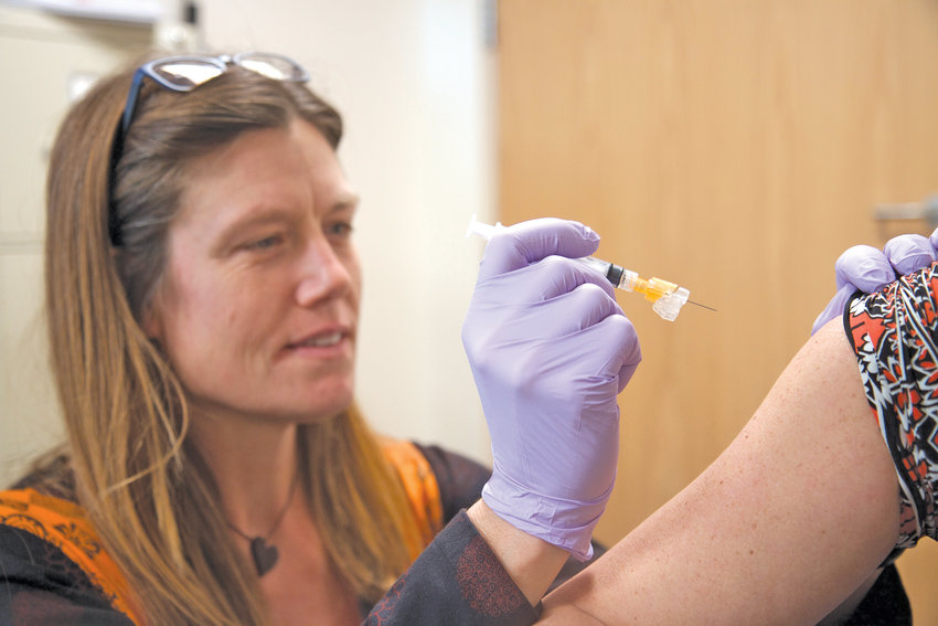 Korinda Dalton, Jefferson Healthcare interim employee health nurse, demonstrates a flu shot injection. Health experts encourage the public to get a flu shot as the current flu season, which began in October, is underway.