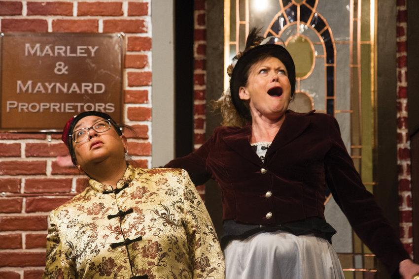 Vickie Daignault, right, plays Henrietta Maynard, the sharpshooting, rum-drinking, twice-divorced proprietor of the Delmonico Hotel on Water Street. Consuelo Aduviso plays the role of the merchant Tze Hong.