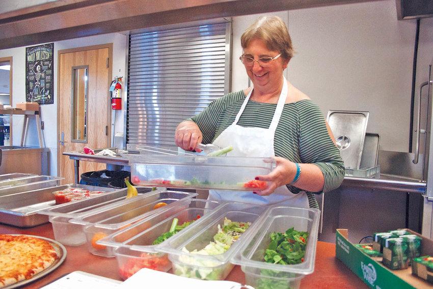 Linda Boyd prepares fresh greens for Chimacum High School students.