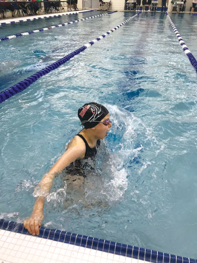 Ursula Schmidt, the REDfins' only 10-and-under swimmer, does an open turn in her 50-yard breaststroke race during the 2018 Pacific Northwest Fall Divisional Swim Meet at the Curtis Aquatic Center in Tacoma.