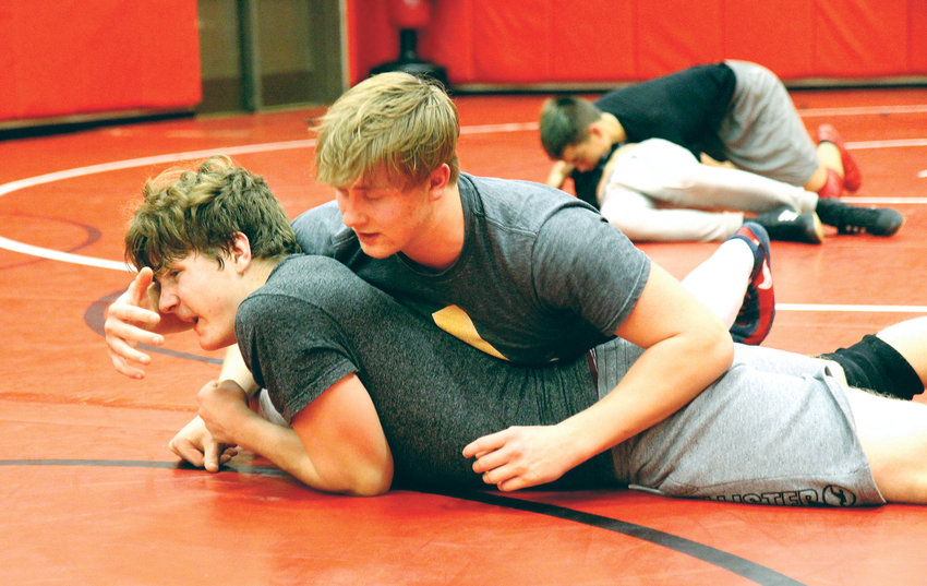 Port Townsend High School junior Wes Blue, top, wrestles teammate Kyle Caldwell, a sophomore from Chimacum High School, during practice Jan. 3.