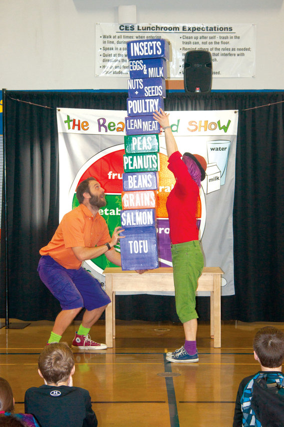 Frank N. Stein, played by Wren Schultz, and Beans Prout, played by Della Plaster of Port Townsend, use circus-style antics Jan. 11 to teach the students at Chimacum Elementary about the importance of a balanced diet and exercise.