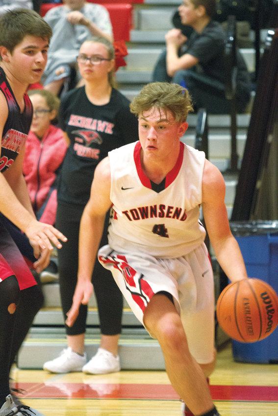 Port Townsend High School senior Nico Winegar, right, grabbed 10 rebounds against Klahowya on Jan. 15 and 16 rebounds against Bear Creek on Jan. 18.