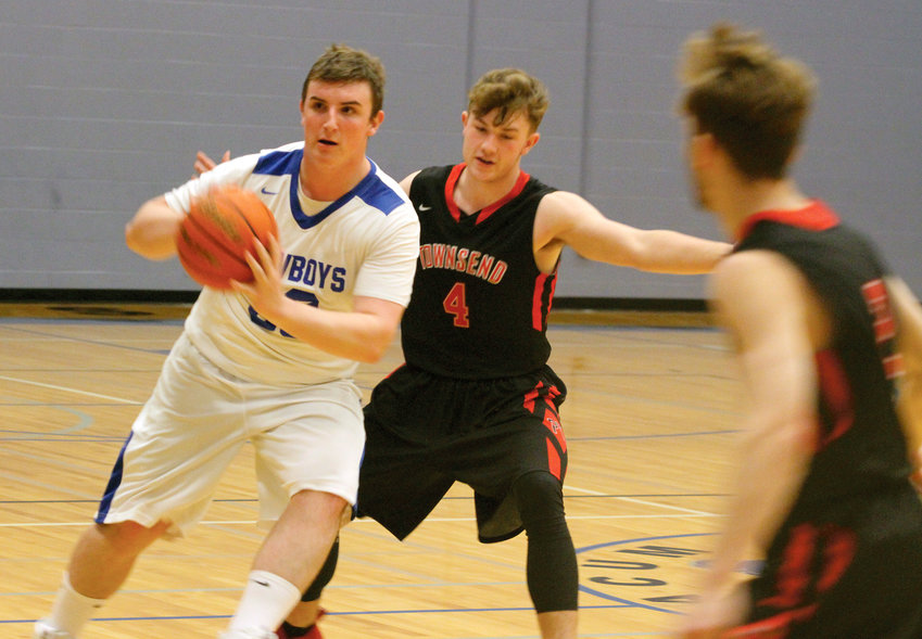 Chimacum High School junior Jacob Williamson passes away from Port Townsend senior Nico Winegar during the teams' Class 1A Olympic League game on Jan. 8. Chimacum won consecutive games last week and is looking to find a consistent rhythm.