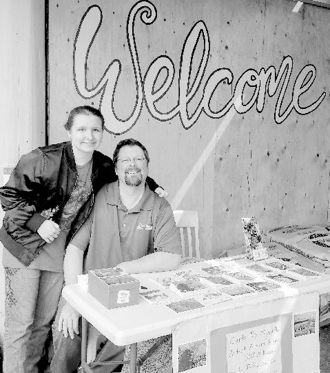 Aloura and Doug Remy sell cards at the Port Townsend Food Co-op to benefit the Land Trust.