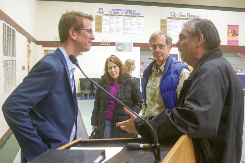 U.S. Rep. Derek Kilmer, D-Gig Harbor, talks with Bill Putney and other Jefferson County residents at the Quilcene School auditorium Feb. 1.