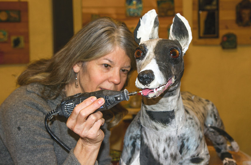 Sarah Fitch has been working with paper machie to craft a life size greyhound based on a  former pet. Her art is on display at Red Dragonfly Gallery,  211 Taylor St., and Galllery 9, 1012 Water. St.