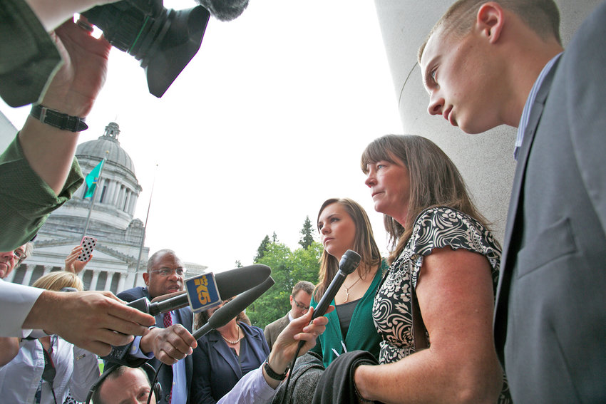 Stephanie McCleary and her children Kelsey and Carter answer questions from the press after the Washington State Supreme Court heard arguments during a Show Cause Hearing concerning the McCleary school funding case, September 3, 2014 in Olympia.
