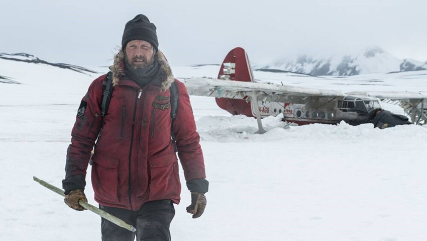 "Joe Penna's directorial debut, ""Arctic,"" is as starkly minimalist as the Icelandic landscape it uses as its backdrop."