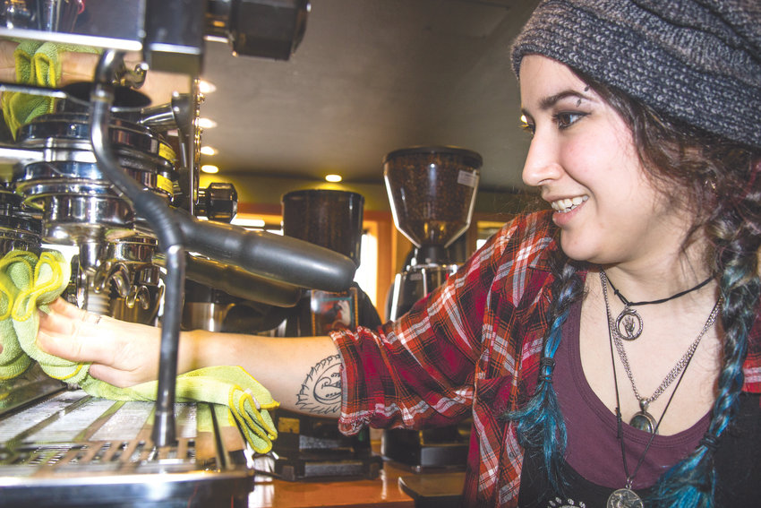 Fox Syncrow, a barista at Sunrise Coffee, says she has enjoyed learning coffee roasting and drink preparation.