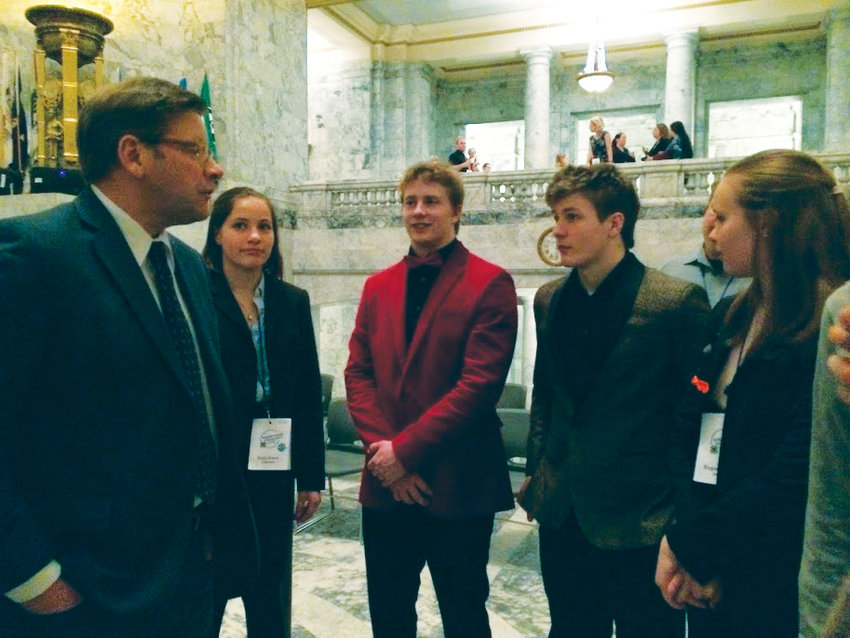 From left, students Viola Frank, Wes Blue, Kyle Caldwell and Eugenia Frank chat with Rep. Mike Chapman in the Capitol Rotunda.