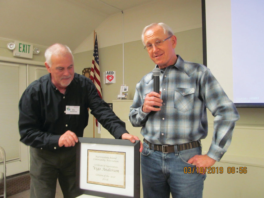 From left, Mike Zimmerman of the Marrowstone Island Community Association presents Vigo Anderson with the Marrowstone Island Citizen of the Year award for 2019.