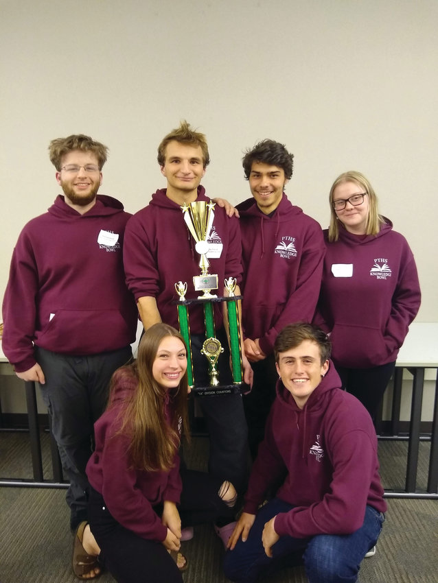 The Port Townsend High School Knowledge Bowl team is all smiles after winning the state tournament March 23. Back row from left, Raphael Bakin, Gabe Petrick, Lou Babik and Karen Absher. Front row from left Jules Short, Henry Stier.