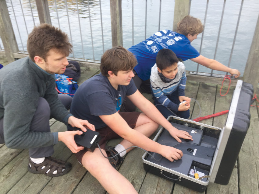 The team placed fourth at the national underwater ROV competition, partly due to their ability to work seamlessly together. Senior Logan Flanagan, ninth-grader Nathaniel Ashford, sixth-grader Ayden Ratliff and seventh-grader Everest Ashford all work in tandem during a saltwater test of their ROV in Port Townsend Bay.