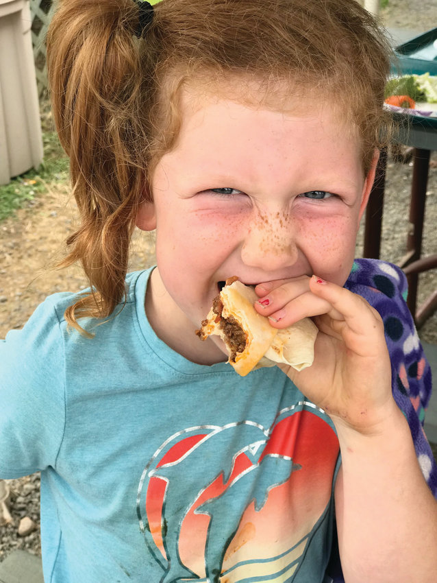 Kids in the YMCA's Summer Meals programs enjoy healthy, organically grown produce, above, and the program's popular street tacos, below.