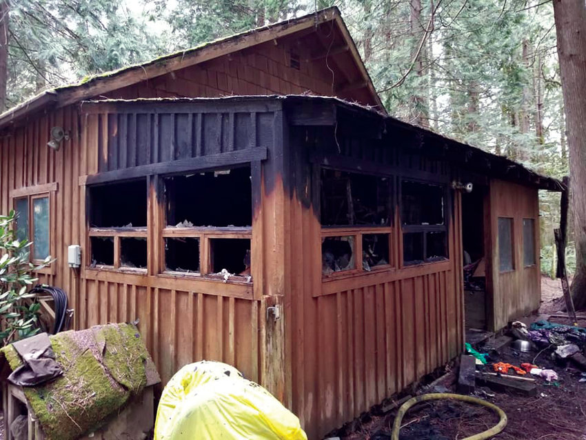 Firefighters surveyed the damage done to a home on Pete Beck Road in Quilcene, after a dryer fire April 10.