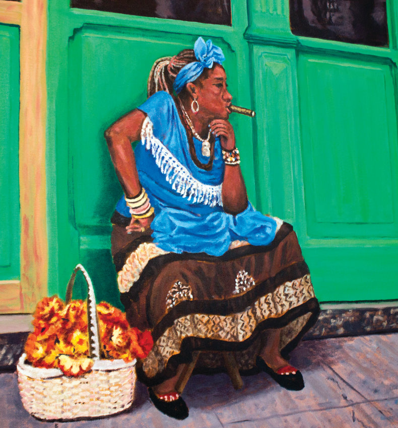 "This painting by Claude Manning, titled ""Cuban Cigar Lady III,"" is on display at Fort Worden along with photos by Scott Pascoe as part of the Art in Gathering Places program, a rotating show of Jefferson County artists. Manning recently returned from a trip to Cuba with his wife, and he was inspired by the vibrant colors."