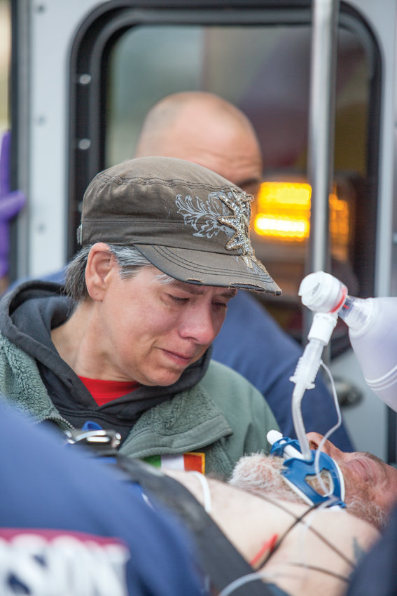 Erika Malloy was by Paul Gomes' side as he was taken to the hospital after suffering a heart attack May 3.