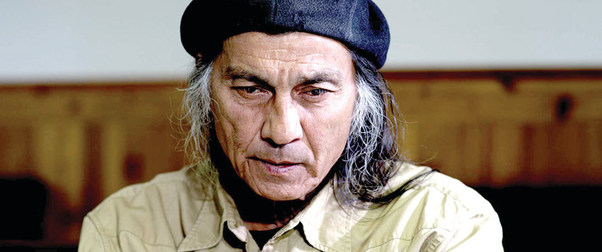 """Richard Ray Whitman as """"Grover"""" confronts the white scholar for his well-meaning but ignorant assumptions about Dan and the Lakota people."""