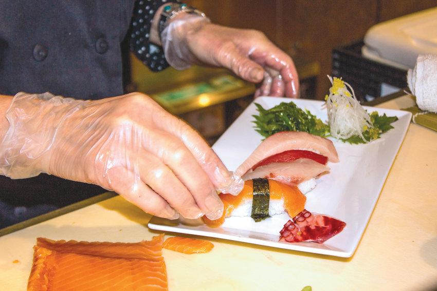 Tomoko Tolson and David Pavlicek are preparing a sampling of fresh sushi for Taste of Port Townsend.