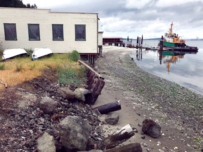 The Northwest School of Wooden Boat Building's aged and worn pilings, girders and seawall, above, were all replaced as part of its $1.5 million in recent upgrades, below.