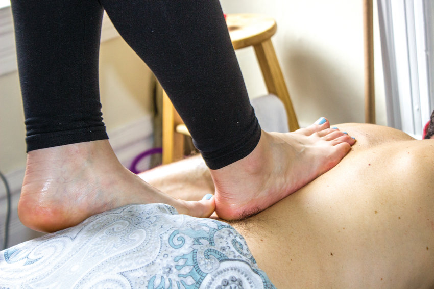 Ashiatsu has an advantage over traditional massage because of the way the practitioner's weight is distributed through the feet, Lippens says.