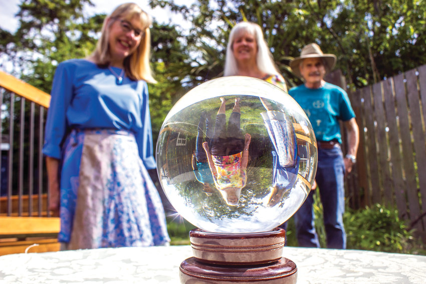 Thirteen psychic readers and five energy workers will set up shop at the Unity Spiritual Enrichment Center during the annual Psychic Faire June 21 and 22. Seen here from left are Joanne Clarkson, Daphne Carrozza and Michael Carrozza.