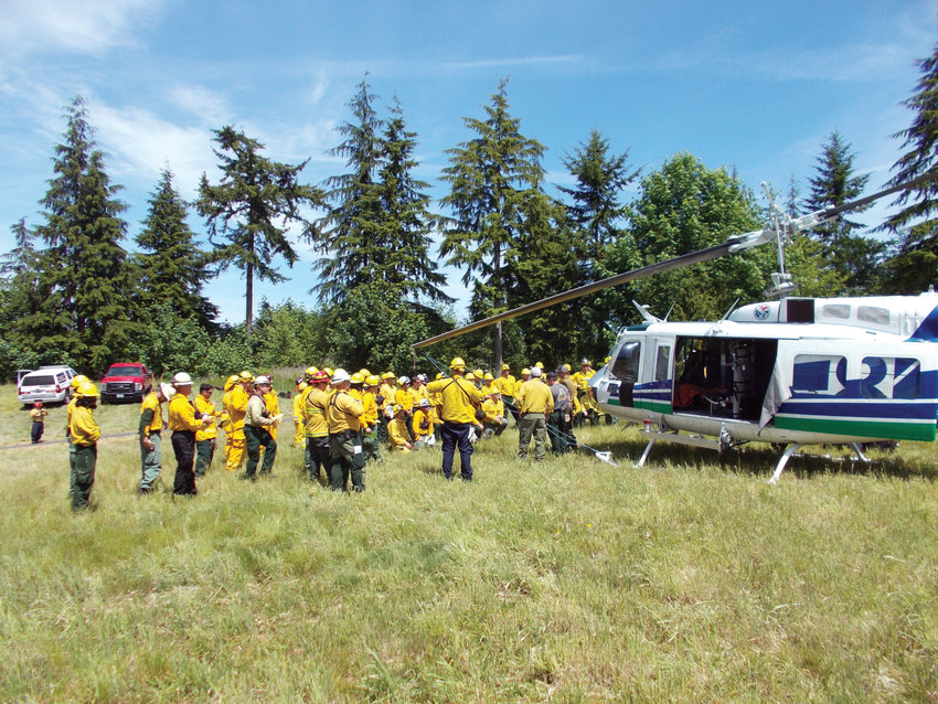 """The two-day wildland firefighting exercise June 1-2 in Port Ludlow at the currently closed Trail 9 golf course involved the Department of Natural Resources' """"Helitack,"""" or helicopter-delivered fire resources, a system of using helicopters and their crews to perform aerial firefighting and other such duties, primarily as part of initial attacks on wildfires."""