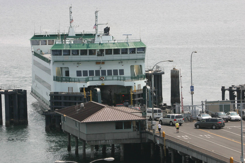 The MV Salish loads a line of cars in Port Townsend, heading to Coupeville, during one of its summer transits. All sailings on the Salish will be suspended for the week starting June 23, and possibly longer.